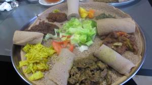 Ethiopian food. Lamb, cabbage,injera bread, and veggies. Mildly spicy.Yum